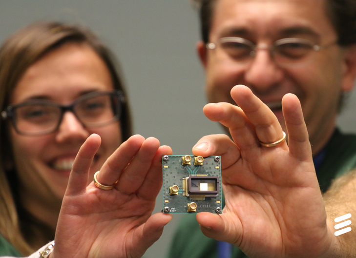 Ericsson researchers, Antonio D'Errico and Teresa Pepe, showing graphene-based photonic switch. Credit: Ericsson