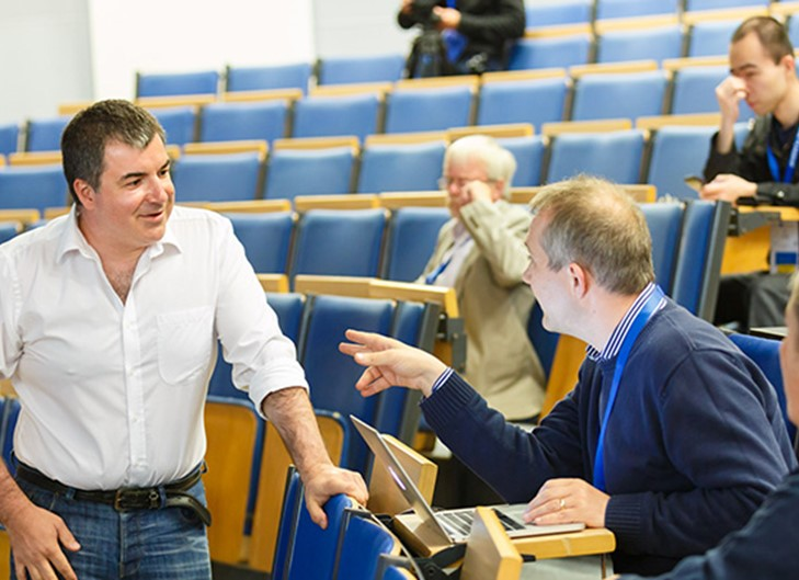 Konstantin novoselov talking to colleagues