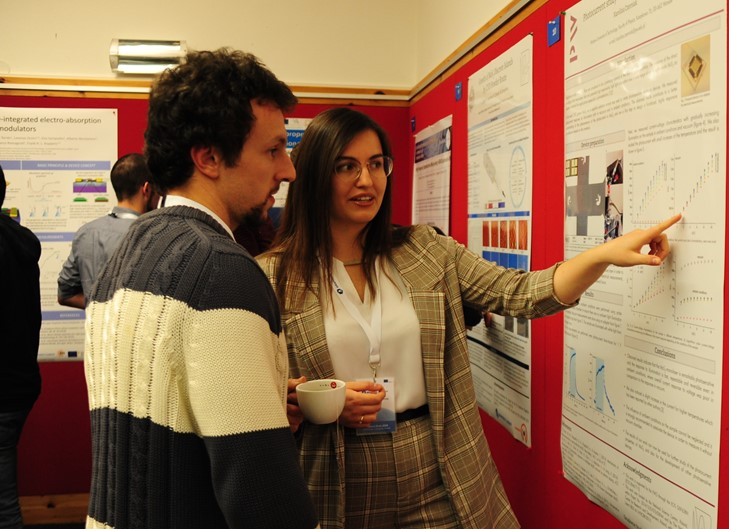 Two people attenting a poster session.