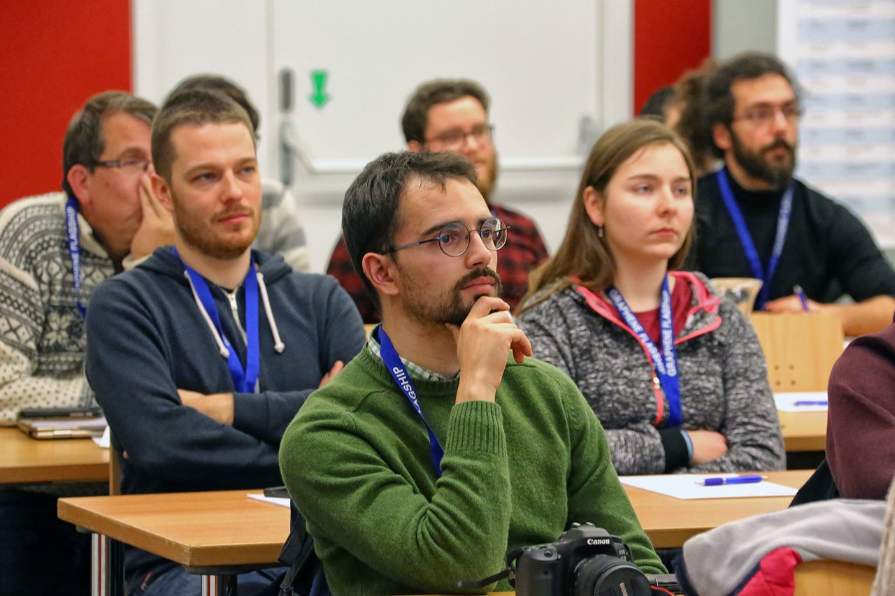Early career researchers attend a lecture at the Graphene Study winter school.