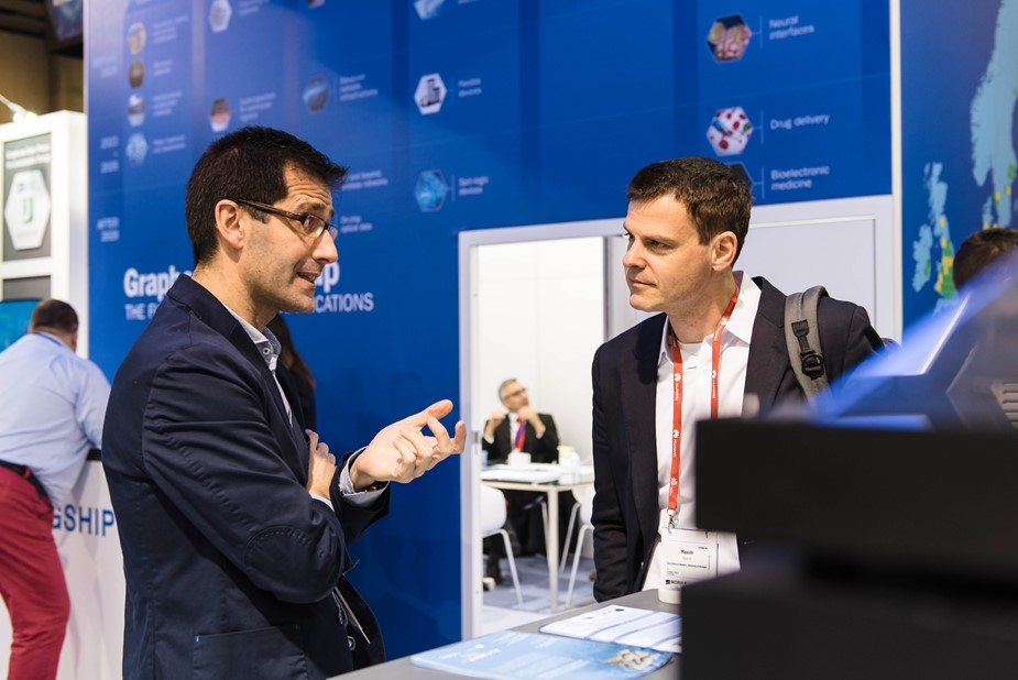 Researcher explaining a prototype at the Graphene Pavilion at Mobile World Congress 2018